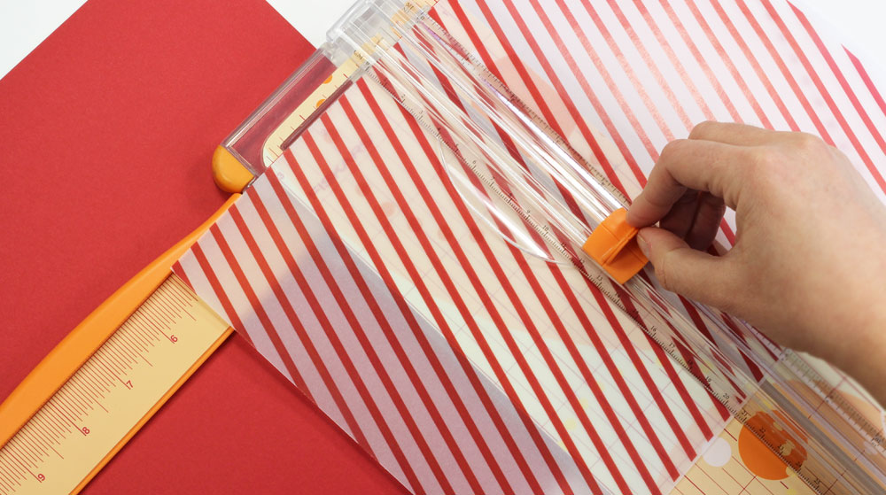 Cut pattern vellum to place behind cutout on holiday card