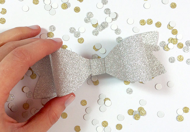 DIY glitter paper bow by Allie & Elle. Step by step instructions in post. Made with MirriSPARKLE glitter paper from LCIPaper.com