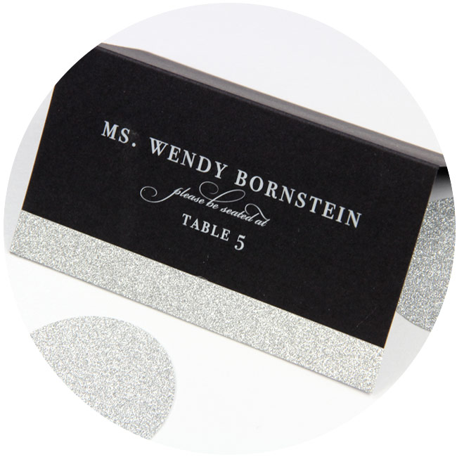 DIY place card idea: Black place card printed in white by LCIPaper.com, decorated with MirriSPARKLE silver glitter paper strip