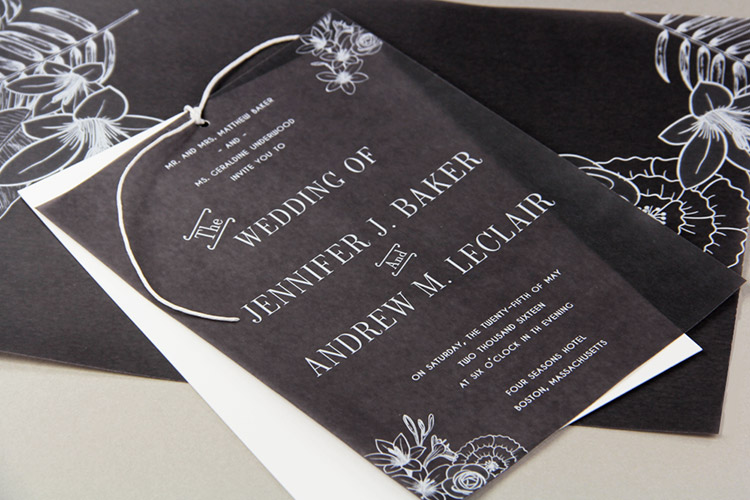 Black and white wedding invitation with black vellum overlay tied on with twine