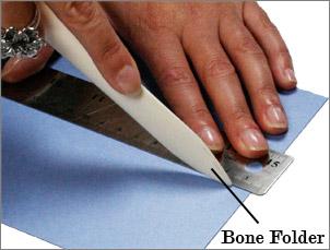 use a bone folder to score paper by hand