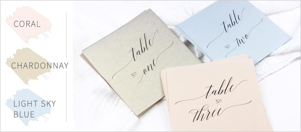 Shimmery metallic table cards in 2019 top trend colors - blush, blue, chardonnay. Custom cut and printed by LCI Paper.