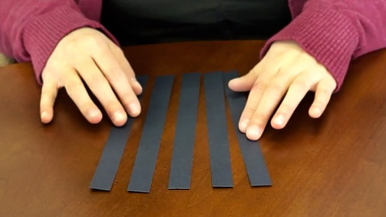 cut five evenly sized strips of paper