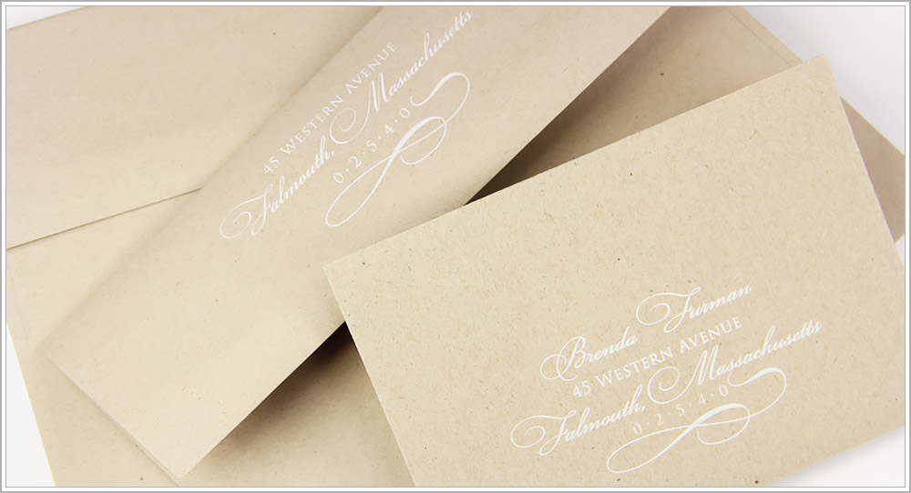 Matching kraft invitation and reply envelopes with custom artwork