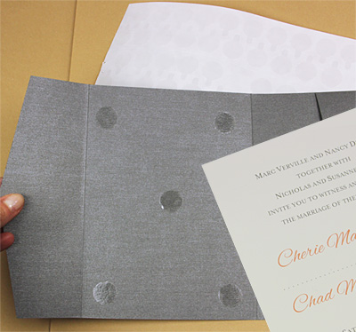 pocket invitation glued with double sided tape dots