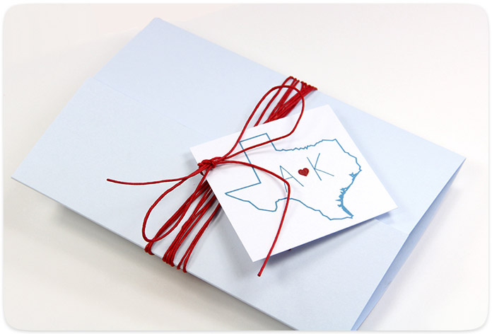 Use hemp twine and a personalized tag to decorate and close gatefold invitation