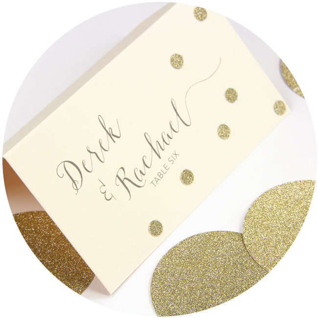 DIY wedding place cards: Ivory place card printed by LCIPaper.com decorated with gold glitter confetti