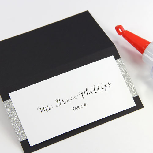 Glue printed layer to glitter layered place card