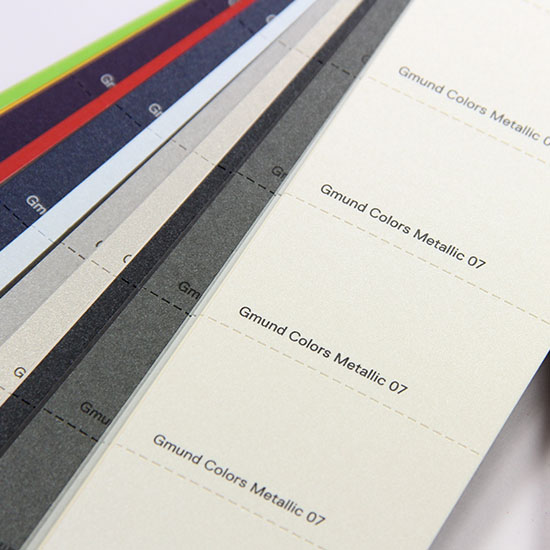 Luxury color system swatch book includes perforated color chips for easy sharing.