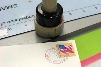 hand cancelling envelopes
