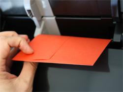 Looking behind A7 envelope in printer