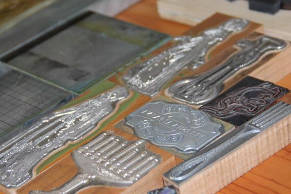 Metal letterpress plates used for larger prints