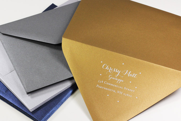 Metallic envelopes for holiday cards custom printed in white by LCIPaper.com