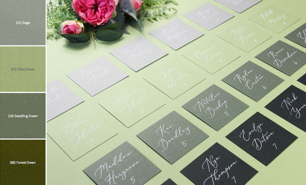 Green ombre seating chart made with flat green place cards printed in white from LCI Paper. Materials list and free template in post. Print at home or order printed.