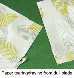 paper frayed from dull paper cutter blade