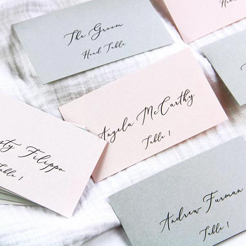 Flat place cards with calligraphy printed by LCI Paper.