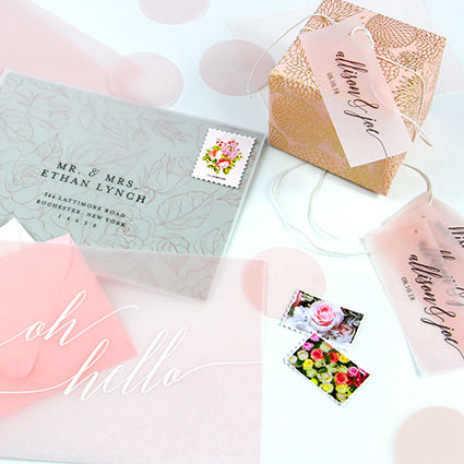 Pink vellum paper used as invitation overlay, favor tag, place cards, confetti