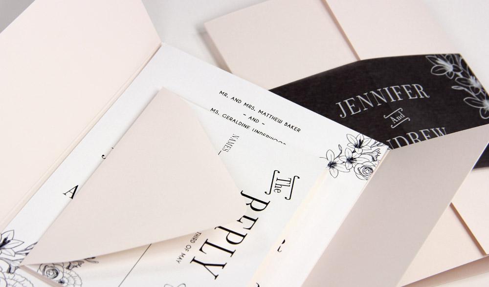 Powder pink, white and black gatefold invitation with black vellum band