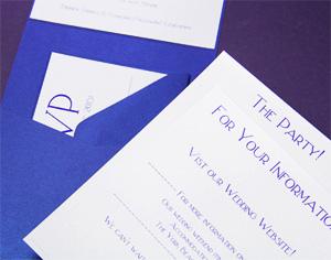 rsvp card behind stack in pocket invite