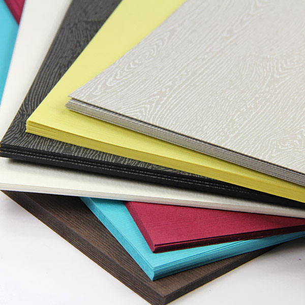 Texture embossed specialty paper in wood, felt, japanese linen finishes