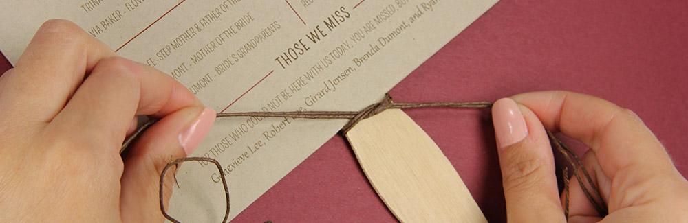 tie twine into a knot around stick