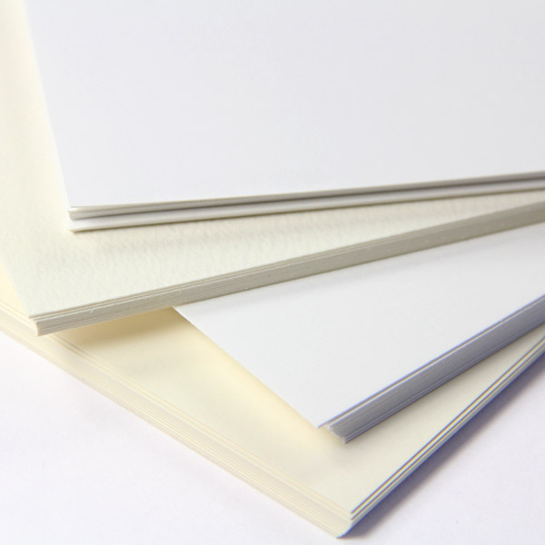 Traditional white and cream specialty paper in smooth, linen, felt, cotton finishes