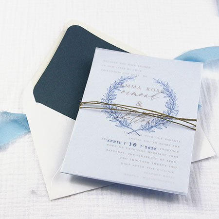 Vellum wedding invitation idea: Colorful, lightweight vellum overlay on top of invitation card to reveal wording beneath.