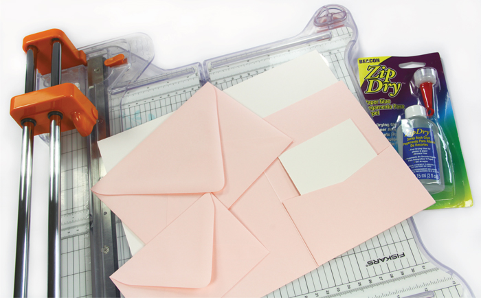 materials to make your own pink watercolor pocket invitation