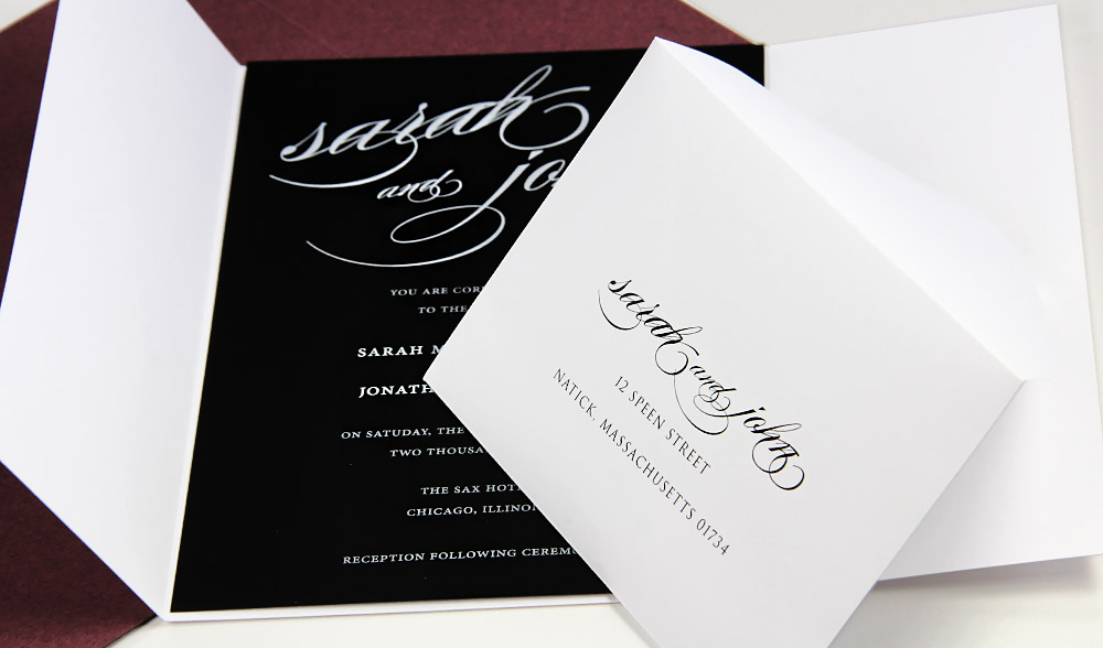 Simple black and white gatefold invitation. Gatefold, envelopes, white printing on black card from LCIPaper.com