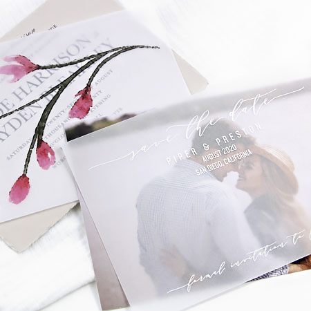 Vellum overlays printed with white ink by LCI Paper. You send your design, they print.