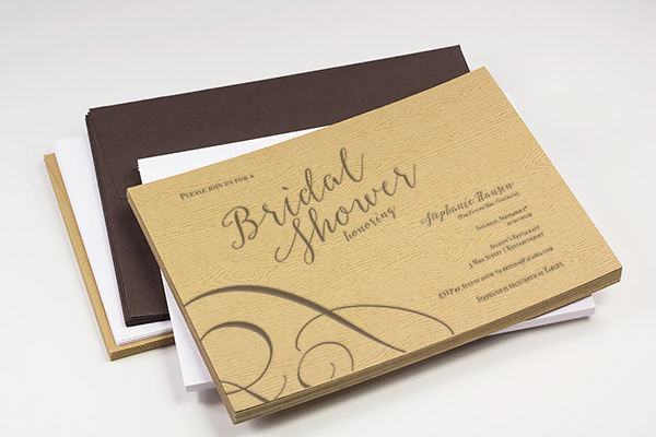 Wood grain bridal shower invitation printed with text parallel to texture in a horizontal layout